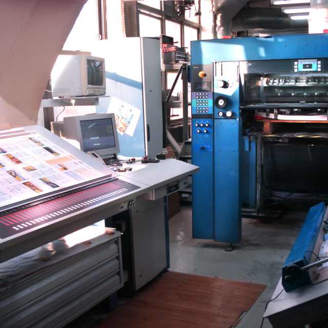 sheet-fed 4 color press and light box in New York's printing district